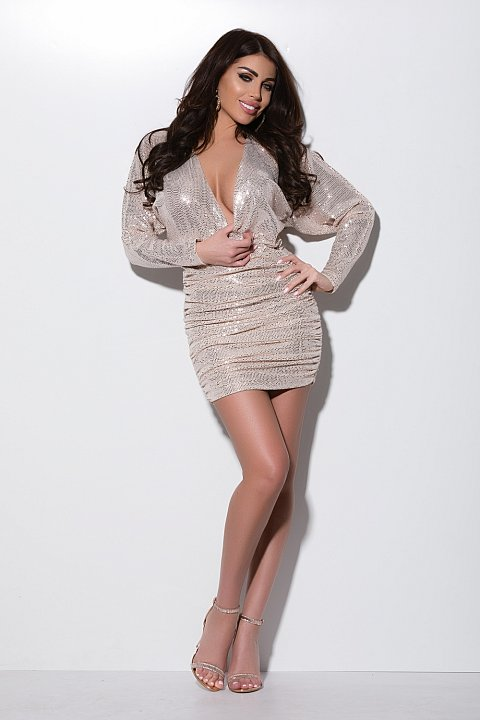 Minidress aderente elegante color beige in micro paillettes.