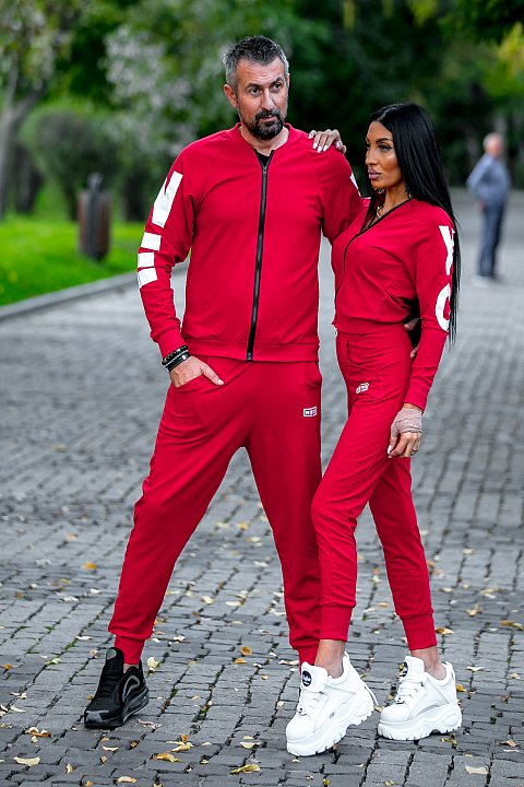 Women's Sports Suit in red with white patch.