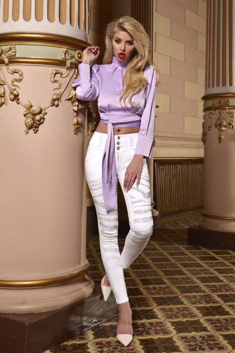 White cigarette jeans with studs.