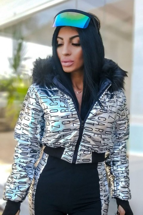 Black and silver winter sports suit with lettering.