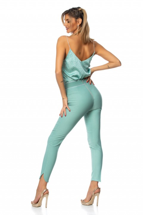 Top in raso color turchese a pois bianchi.