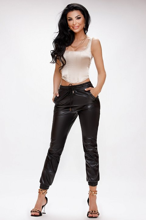 Sports trousers in black eco-leather.