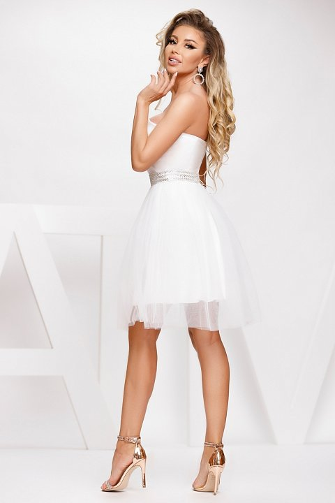 Short princess dress in white with jeweled belt.