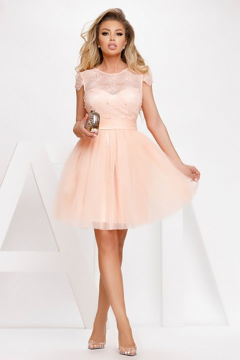 Peach pink princess dress in textured tulle.