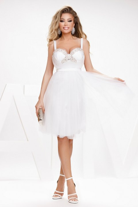 White princess dress with applied embroidery.