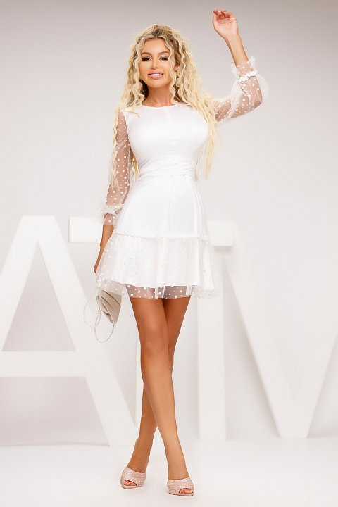 White doll dress in textured tulle.