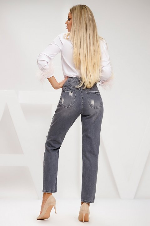 Distressed gray wash jeans.