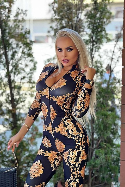 Slim jumpsuit in black lycra with gold pattern.