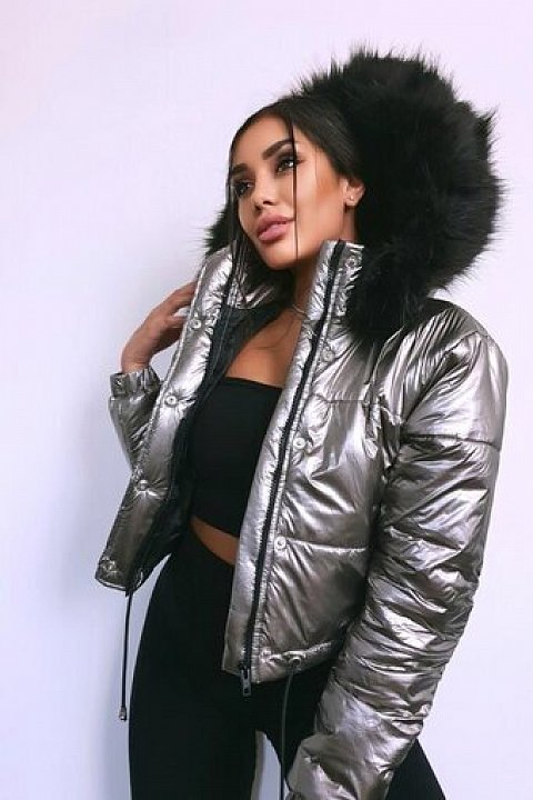 Silver-colored high-neck bomber jacket.
