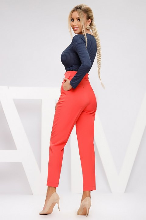 Coral red cady capri trousers with belt.
