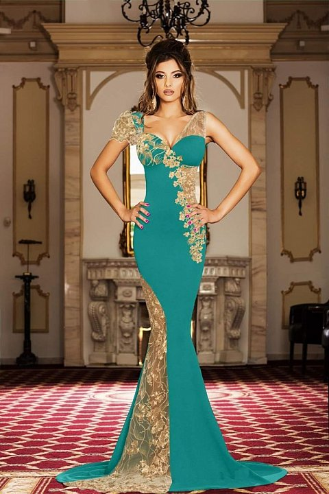 Elegant long turquoise dress with transparencies and embroidery.