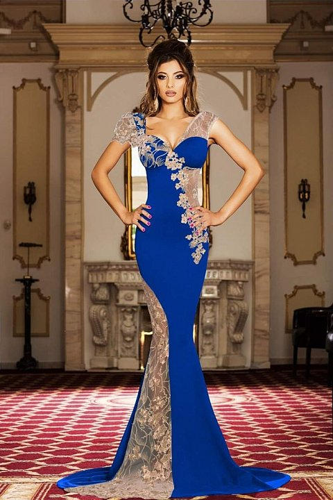 Elegant long royal blue dress with transparencies and embroidery.