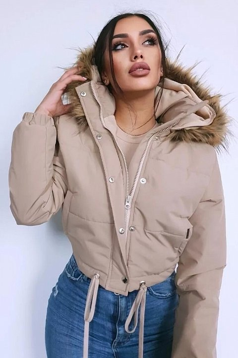 Beige bomber jacket with high collar.