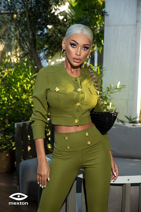 Green casual suit with golden buttons.