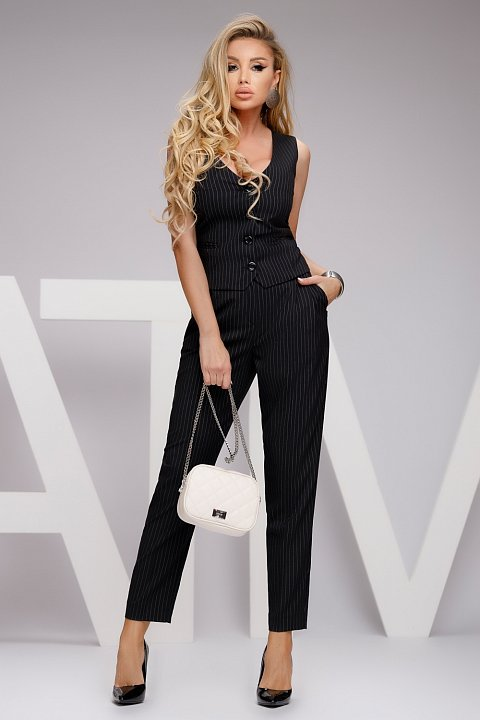 Black pinstripe trousers with pleats.