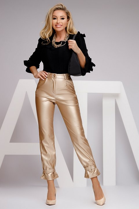 Casual gold-colored faux leather trousers