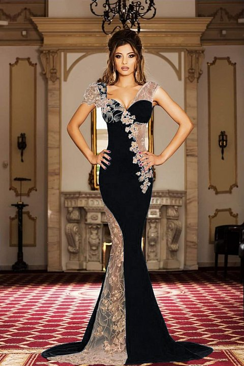 Elegant long black dress with transparencies and embroidery