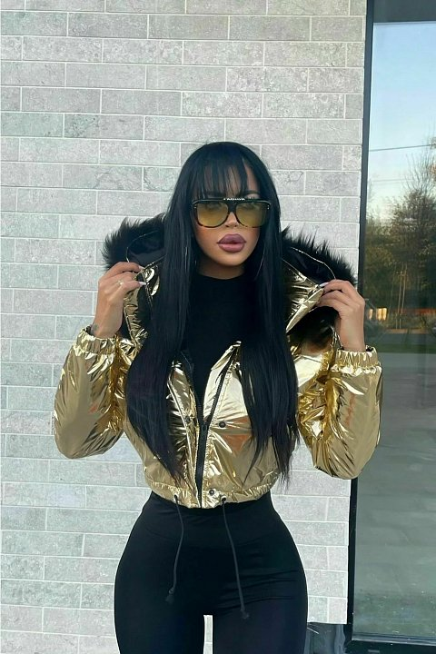 Gold-colored bomber jacket in shiny vinyl fabric.