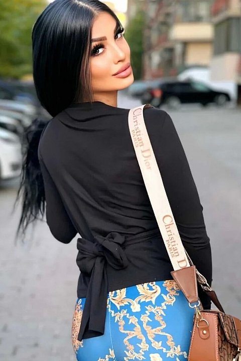 Black jersey sweater with drapery.